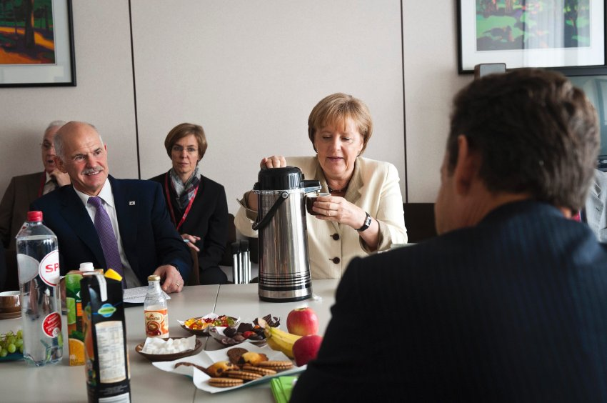 German Chancellor Angela Merkel (C), Greece's Prime Minister George Papandreou (L) and France's President Nicolas Sarkozy (R) attend a meeting in Brussels July 21, 2011
